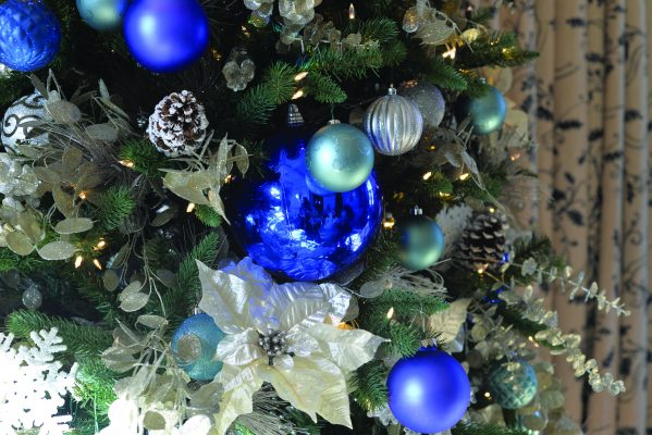 GLANWORTH GARDENS: The Victoria Old World theme is carried through to the loggia with its Christmas tree that combines blue and white ornaments that coordinate to match the predominate color scheme of the room.