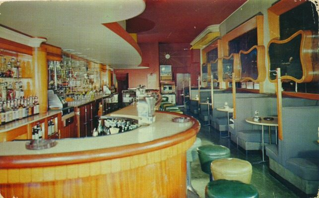 George Lazzaroni and his siblings converted the family's ice cream parlor into the Clair Lounge, a sleek art deco space with a curved bar and booths along the wall. Hanging next to each booth were large-format photo prints of Lake Geneva scenes produced by Vern and Alice Hackett.