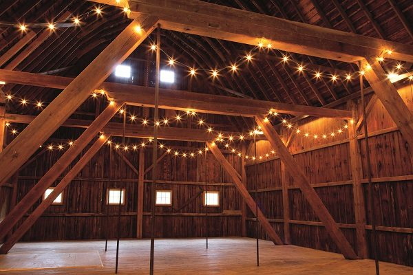 The German suspension barn, shown above, served as the Humls' home for the first two years of the project as they worked to restore the farmhouse. Today it is used for parties and special events.