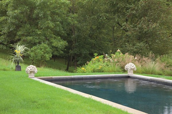 "The most recent addition to the farm is a swimming pool. ""The grandchildren love it,"" Joyce says."