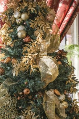 Holiday decorations throughout the house, including those on the front porch provide a festive atmosphere.