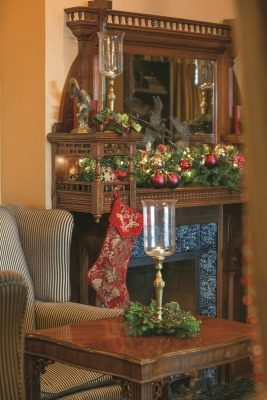 Holiday décor beautifully highlights the detailed craftsmanship of the library's fireplace mantel.