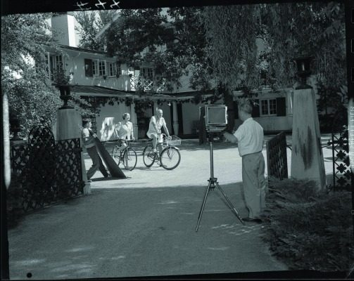A photographer captures the Lunts bicycling in the courtyard of the main house at Ten Chimneys.