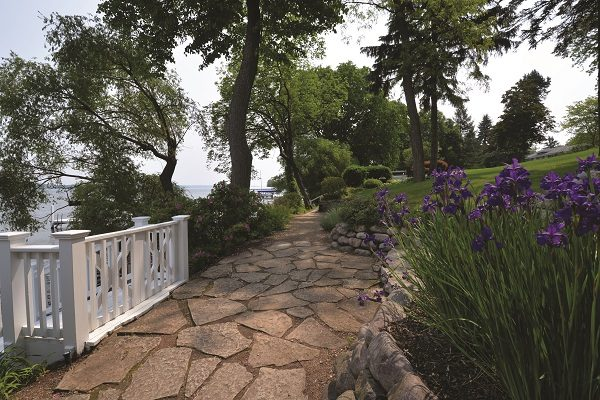 A portion of the Path on the south shore near Fontana is paved in flagstone and landscaped with a rock wall and a bed of irises.