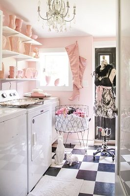 The chic, perfectly pink laundry room turns a mundane task into a bit of fun.