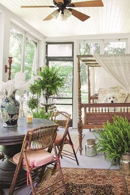 The home's sleeping porch is readied with two antique beds and a Victrola, creating an ideal place to daydream the afternoon away as sweet Lucy can attest.
