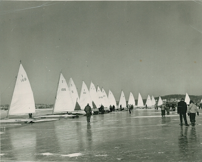 Photo taken about 1950 shows a regatta on Geneva Lake. Current Skeeter Ice Boat Fleet Captain Steve Schalk was able to identify the following boats: I 169 - Jane Wiswell (later Pegel), Williams Bay; I 186 - Sylvester Beers, Fontana; I 5 - Tom Jones, Fontana; IOU sail - Bill Perrigo, Pewaukee; and F 43 - F.A. Brown, Fox Lake, IL.