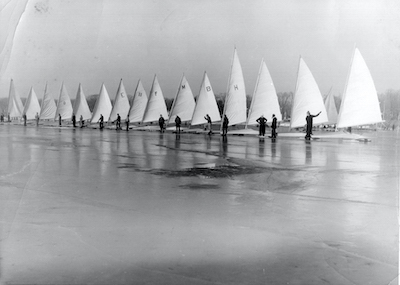 Original Skeeters built by Beauvais, Palmer, Geneva Lake Boat Company, Mead and home builders lined up on Geneva Lake around 1935. (This is what the boats looked like when the Skeeter Ice Boat Club was founded in 1933.) The boats did not yet have springboards on the bows to provide a suspension. Note: Sail numbers were not yet used for racing, instead some racers used their initials.